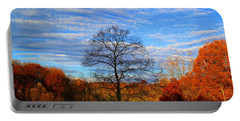 Portable Battery Charger featuring the photograph Treetops Sunrise by Kathryn Meyer