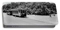 Portable Battery Charger featuring the photograph Trolley With Cloisters by Cole Thompson