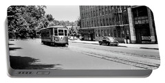 Portable Battery Charger featuring the photograph Trolley With Packard Building  by Cole Thompson