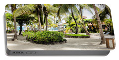 Portable Battery Charger featuring the photograph Tropical Courtyard by Lawrence Burry