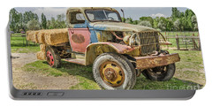Portable Battery Charger featuring the photograph Truck Of Many Colors by Sue Smith