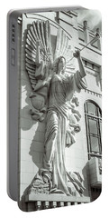 Portable Battery Charger featuring the photograph Trumpeting Angel by Guy Whiteley