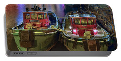 Portable Battery Charger featuring the photograph Tug Boats At Night by Frozen in Time Fine Art Photography