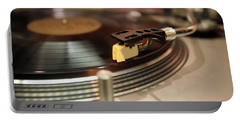Turntable Portable Battery Charger by Gunter Nezhoda