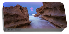 Twilight Moon Rising Over Hutchinson Island Beach Rocks Portable Battery Charger by Justin Kelefas