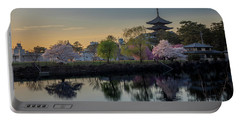 Portable Battery Charger featuring the photograph Twilight Temple by Rikk Flohr