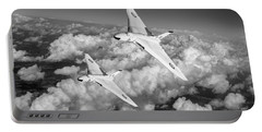 Portable Battery Charger featuring the photograph Two Avro Vulcan B1 Nuclear Bombers Bw Version by Gary Eason