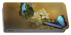 Two Blue Morpho Butterflies On White Spring Flowers Portable Battery Charger
