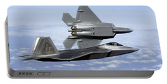 Portable Battery Charger featuring the photograph Two F-22a Raptors In Flight by Stocktrek Images
