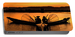 Portable Battery Charger featuring the photograph Two Fisherman At Sunset by Pradeep Raja Prints