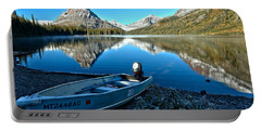 Portable Battery Charger featuring the photograph Two Medicine Motorboat by Adam Jewell