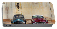 Portable Battery Charger featuring the photograph Two Old Vintage Chevys Havana Cuba by Charles Harden