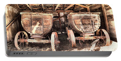 Portable Battery Charger featuring the photograph Two Old Wagons by Jeff Swan