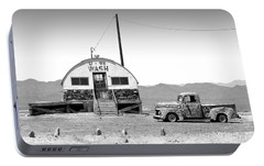 Portable Battery Charger featuring the photograph U - We Wash - Death Valley by Mike McGlothlen