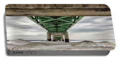 Portable Battery Charger featuring the photograph Under Mackinac Bridge Winter by John McGraw