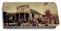 Portable Battery Charger featuring the photograph Unionville Genral Store by Joel Witmeyer