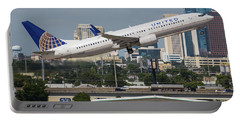 Portable Battery Charger featuring the photograph United Airlines by Dart Humeston