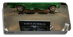Portable Battery Charger featuring the photograph Untamed by Randy Scherkenbach
