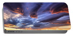 Portable Battery Charger featuring the photograph Alien Cloud Formations by Lynn Hopwood