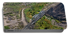 Portable Battery Charger featuring the photograph Up Tracks Cross The Mojave River by Jim Thompson
