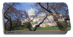 Us Capitol Building And Cherry Portable Battery Charger by Panoramic Images
