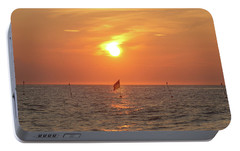Portable Battery Charger featuring the photograph Us Flag Floating At Sunrise by Robert Banach