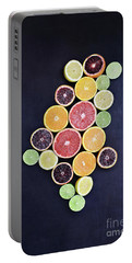 Portable Battery Charger featuring the photograph Variety Of Citrus Fruits by Stephanie Frey