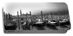 Portable Battery Charger featuring the photograph Venice Gondolas Black And White by Rebecca Margraf