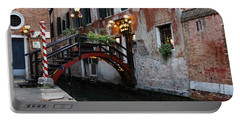 Venice Italy - The Cheerful Christmassy Restaurant Entrance Bridge Portable Battery Charger by Georgia Mizuleva