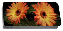 Vibrant Gerbera Daisies Portable Battery Charger by Terence Davis