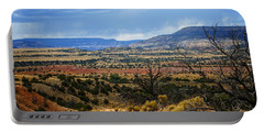 Portable Battery Charger featuring the photograph View From Ghost Ranch, Nm by Kurt Van Wagner