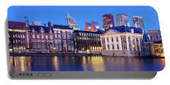 Portable Battery Charger featuring the photograph View Of Mauritshuis And The Hofvijver - The Hague by Barry O Carroll