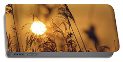 View Of Sun Setting Behind Long Grass C Portable Battery Charger