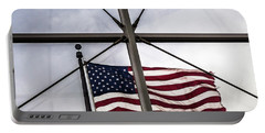 View Of The American Flag Through The Glass Dome Of The Overture Center Portable Battery Charger
