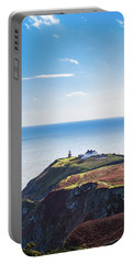 View Of The Trails On Howth Cliffs With The Lighthouse In Irelan Portable Battery Charger by Semmick Photo