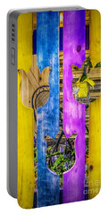 Portable Battery Charger featuring the photograph View Thru The Fence by Nick Zelinsky