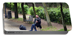 Portable Battery Charger featuring the photograph Villa Borghese Accordionist by Harvey Barrison