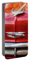 Portable Battery Charger featuring the photograph Vintage Chevy Hood Ornament Havana Cuba by Charles Harden