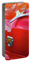 Portable Battery Charger featuring the photograph Vintage Ford Hood Ornament Havana Cuba by Charles Harden