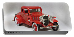 Portable Battery Charger featuring the photograph Vintage Model Fire Chiefcar by Linda Phelps