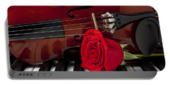 Violin And Rose On Piano Portable Battery Charger