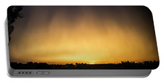 Virga And Sunrise Portable Battery Charger by Karen Slagle