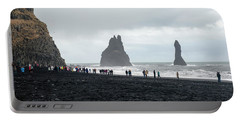 Portable Battery Charger featuring the photograph Visitors In Reynisfjara Black Sand Beach, Iceland by Dubi Roman