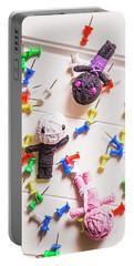 Voodoo Dolls Surrounded By Colorful Thumbtacks Portable Battery Charger