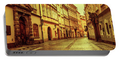 Portable Battery Charger featuring the photograph Walking In Prague. Series Golden Prague by Jenny Rainbow