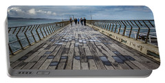 Portable Battery Charger featuring the photograph Walking The Pier by Perry Webster