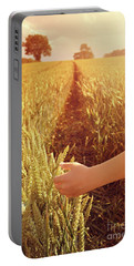 Portable Battery Charger featuring the photograph Walking Through Wheat Field by Lyn Randle
