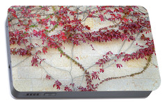 Portable Battery Charger featuring the photograph Wall Of Leaves 2 by Dubi Roman