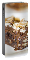 Walnut Brownie On A White Plate Portable Battery Charger