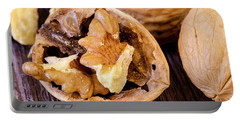 Walnuts On Wooden Table Portable Battery Charger